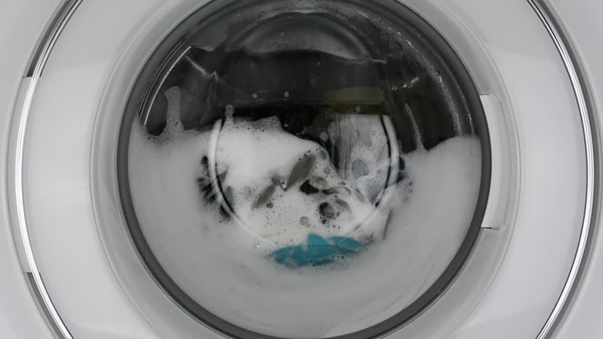 Washing machine washing clothes./ Washing clothes with laundry detergent. #17152594