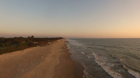 Aerial video Ocean Front at sunset in Goa, India