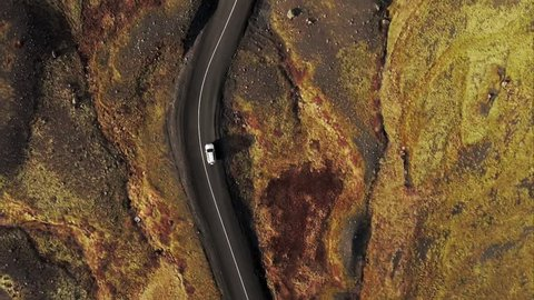 Directly above shot of car driving along a road through the open fields in Iceland