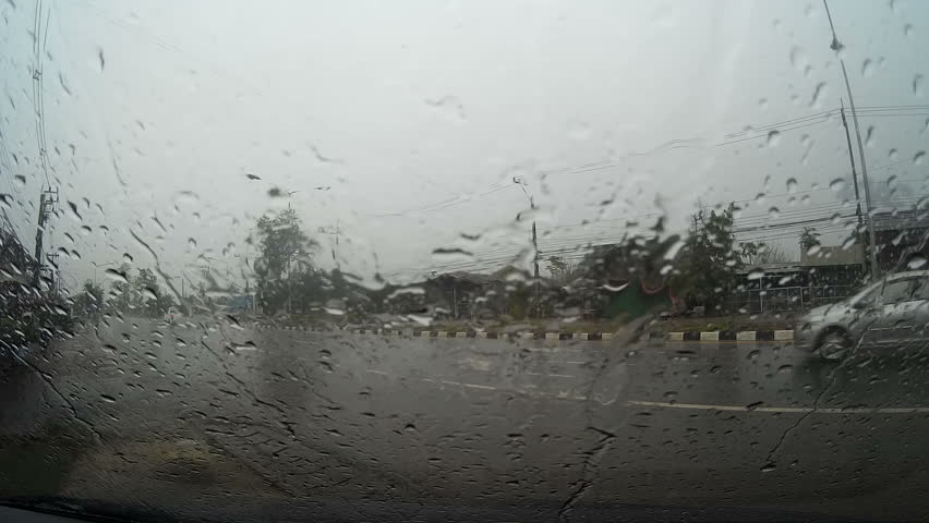 Road view through car windshield with rain drops, Waiting for cross the road - HD stock video clip
