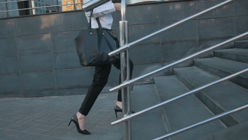 Businesswoman Legs In High-Heeled Shoes Walking Up Stairs On Stairway. Sexy Woman near Office after Work. Student girl go to lessons. | Shutterstock HD Video #17213146