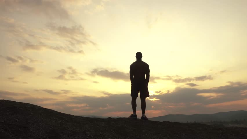 Beauty of human's body. African american bodybuilder posing at sunset or sunrise during his outdoor training. Moment of full harmony and relaxing in sport | Shutterstock HD Video #17251504