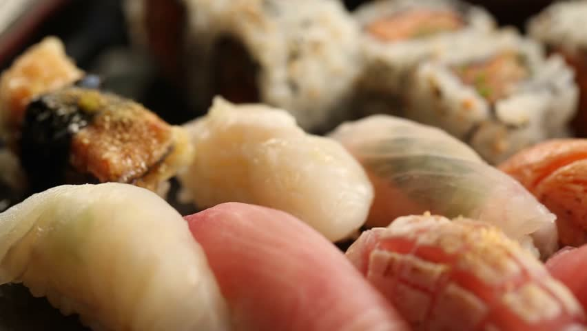 Pan shot of a variety of sushi taken with macro lens #17254504