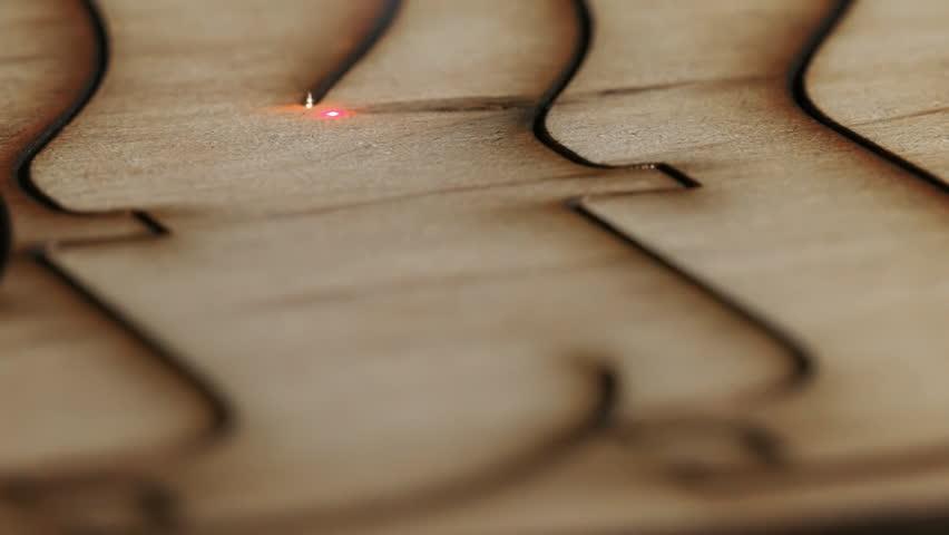 Laser cutting on wood. Slow motion. | Shutterstock HD Video #17296054