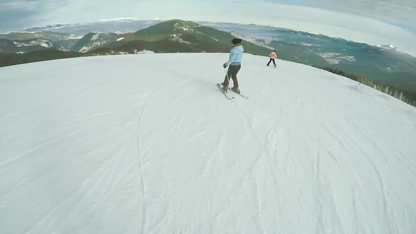 Riding on skis woman down road | Shutterstock HD Video #17308684