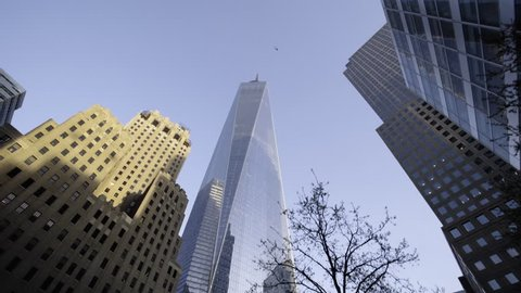 A dolly/tracking shot of New York City's World Trade Center in the spring as trees and flowers blossom. New York - April 1, 2016
