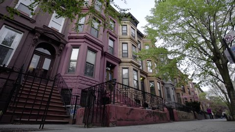 A view of Brooklyn's iconic Brownstone homes from the view of the street. New York - April 1, 2016