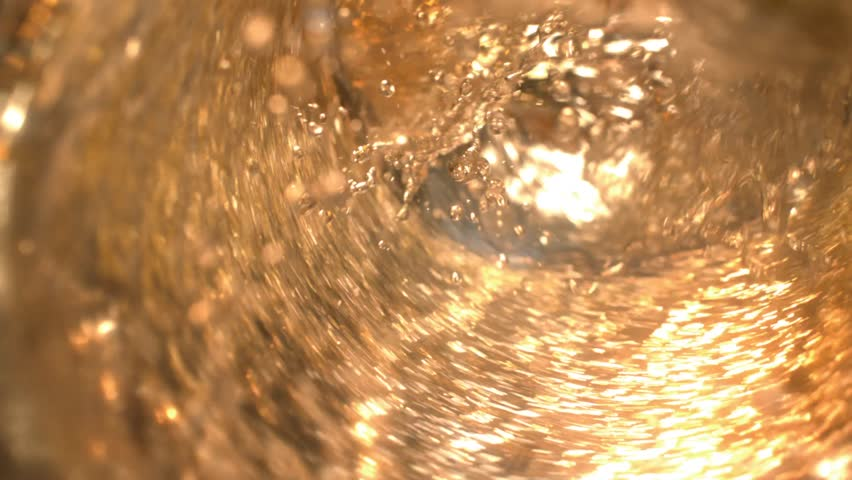 Beer Pouring Into a Glass in Slow Motion at 1500 fps Macro With Splashes and Drops Tabletop 1080p