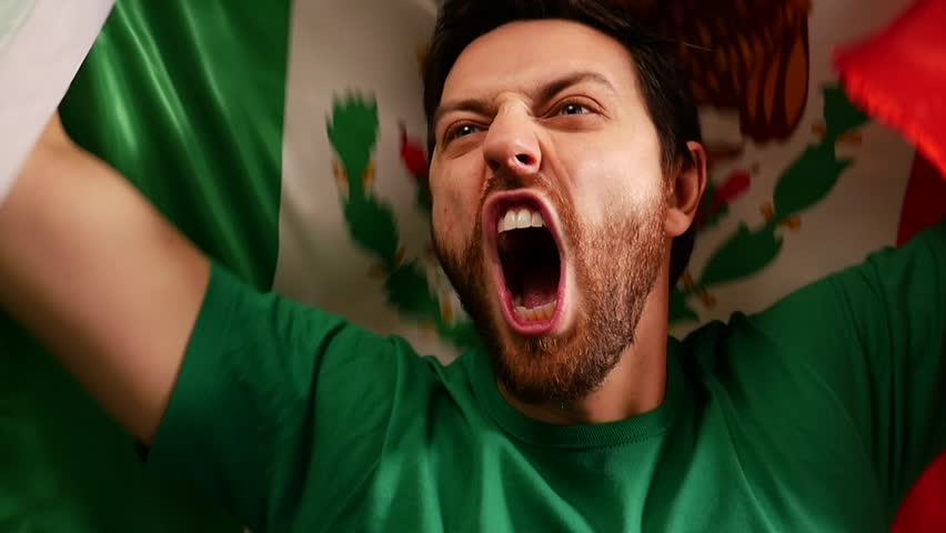 Mexican fan celebrates holding the flag of Mexico in Slow Motion