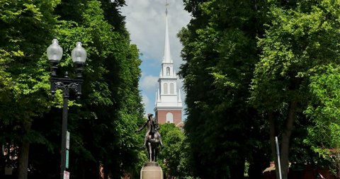 An establishing shot of the Paul Revere Statue near the Old North Church on the Freedom Trail in Boston.