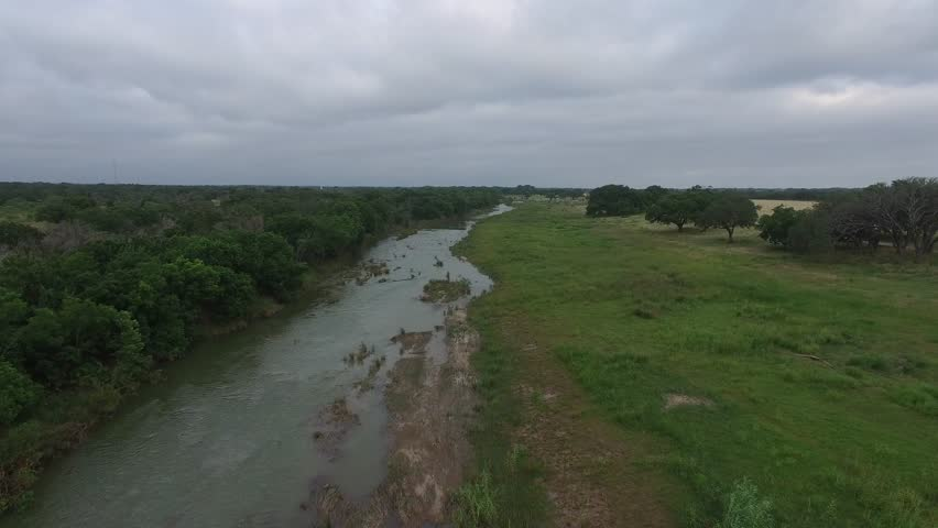 Aerial flight over the Pedernales River in Stonewall Texas.   Shutterstock HD Video #17397694