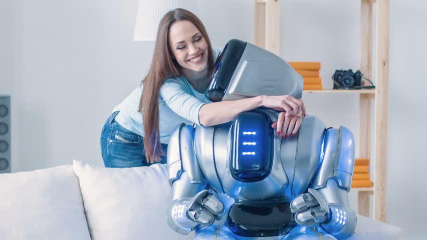Nice smiling woman embracing modern robot