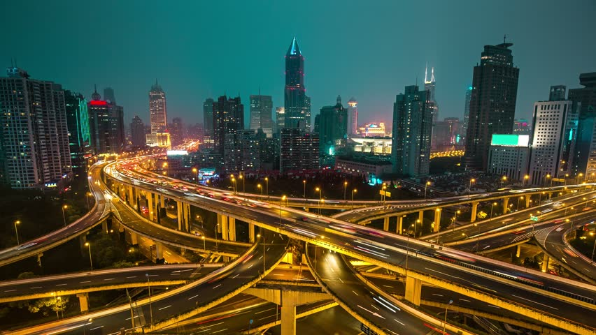 Famous highway intersection in Shanghai, China. Many intersecting highways with fast moving traffic. Time lapse.