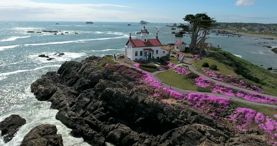 Flying around lighthouse at Crescent City, northern California, with spring flowers in bloom.
