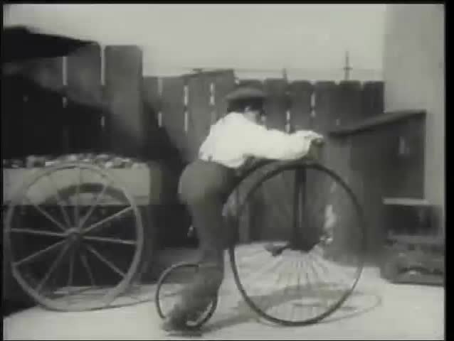 19th century reenactment of boy riding penny farthing, 1930s