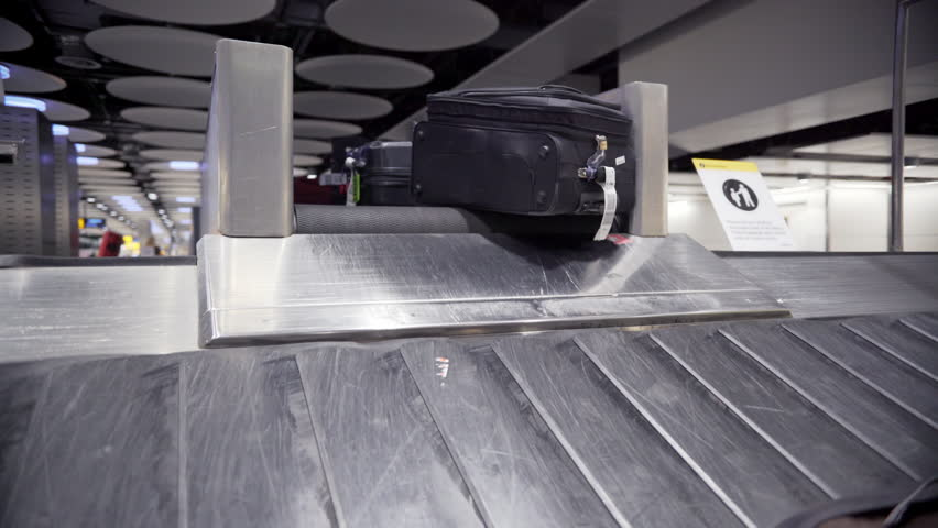 Baggage on luggage carousel at ,Heathrow Airport, London