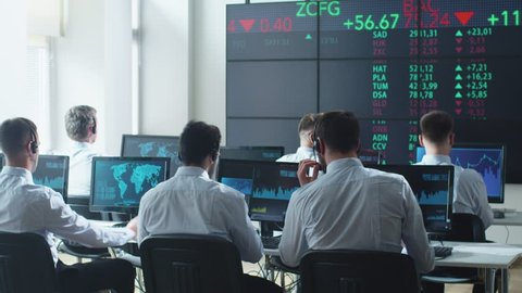 Group of Stockbrockers Actively Working at Stock Exchange. Shot on RED Cinema Camera in 4K (UHD).