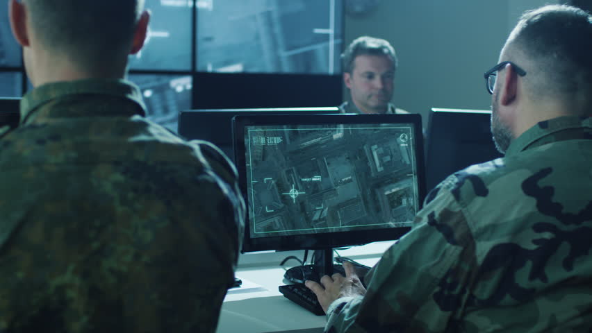 Group of Military IT Professionals in Monitoring Room on Military Base. Shot on RED Cinema Camera in 4K (UHD). | Shutterstock HD Video #17573254