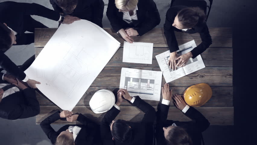 Business people group on meeting with construction engineer business people group on meeting with construction engineer architect looking at building blueprint stock footage video 17600164 shutterstock malvernweather Gallery