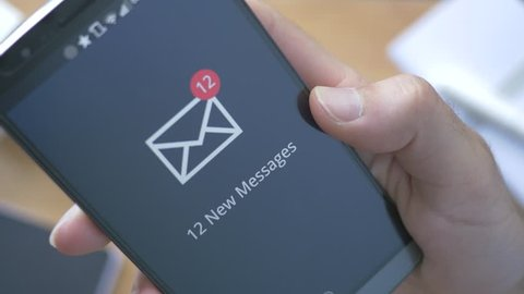 Smart phone receiving 12 new messages.