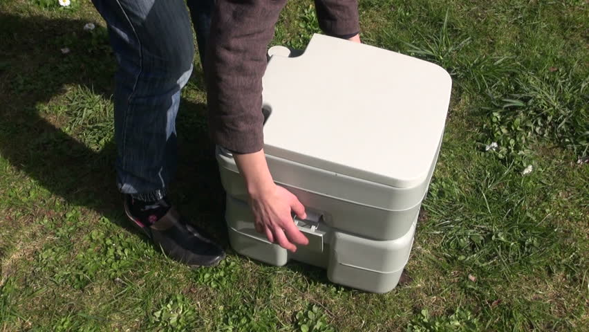 Cleaning portable home bio toilet | Shutterstock HD Video #17664520