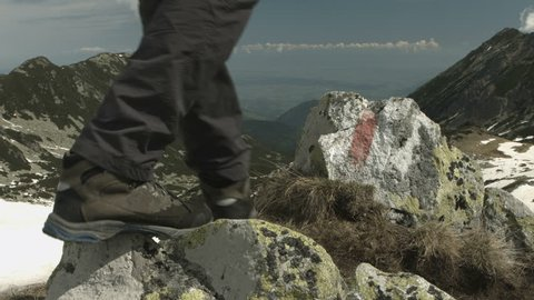 Hiker reaching the top pf the mountain. Blackmagic 4k camera