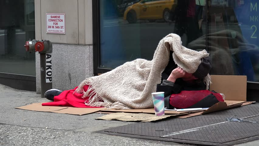 NEW YORK SITY, - MAY 06: Homeless man sleeps on the NYC street. May 06, 2016 in NYS, New York, USA