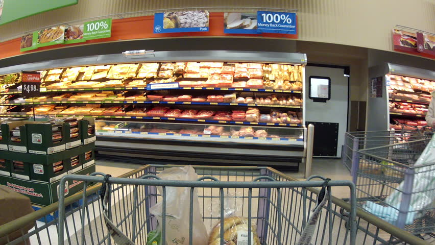 EPHRAM, UT - DEC 13 - (Fast Motion) Consumers purchase goods at Walmart during the busy holiday season December 13, 2011 in Ephram, Utah.