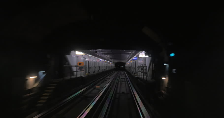 Underground train departing from one station and arriving to another one. Way through the dark subway tunnel | Shutterstock HD Video #17733634