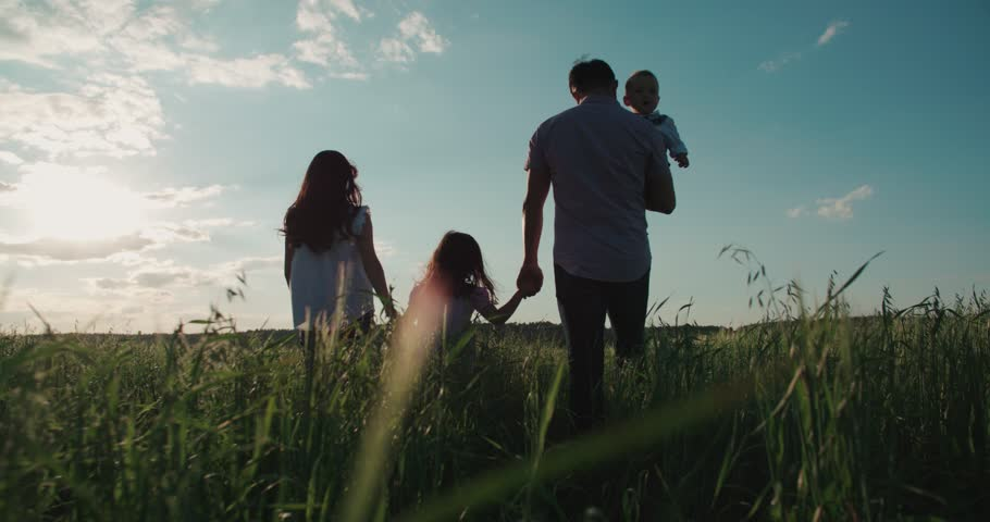 young happy Asian family goes on a green field with two children, slow motion | Shutterstock Video #17745724