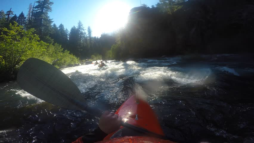 Man kayaking Natural Bridge section of the Rogue River in Southern Oregon