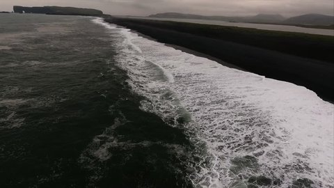 Fly Forward Then Look Down Shot Of Seashore At Black Sand Beach in V\xCC_k Iceland
