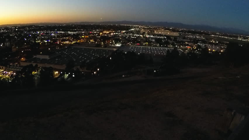 Tilt shot of Los Angeles California city lights just after the sun has set. A hill top view provides a look over bustling city sprawl slipping into the evening. | Shutterstock HD Video #17865484