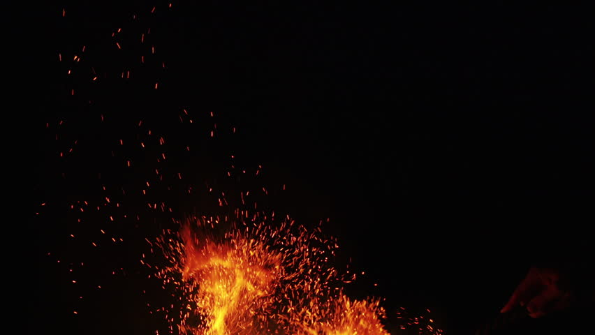 fire sparks from campfire over black background