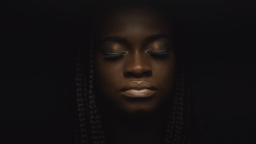 Surreal close-up portrait of young african american female model with gold glossy makeup. Face art. Fashion concept | Shutterstock HD Video #17880406