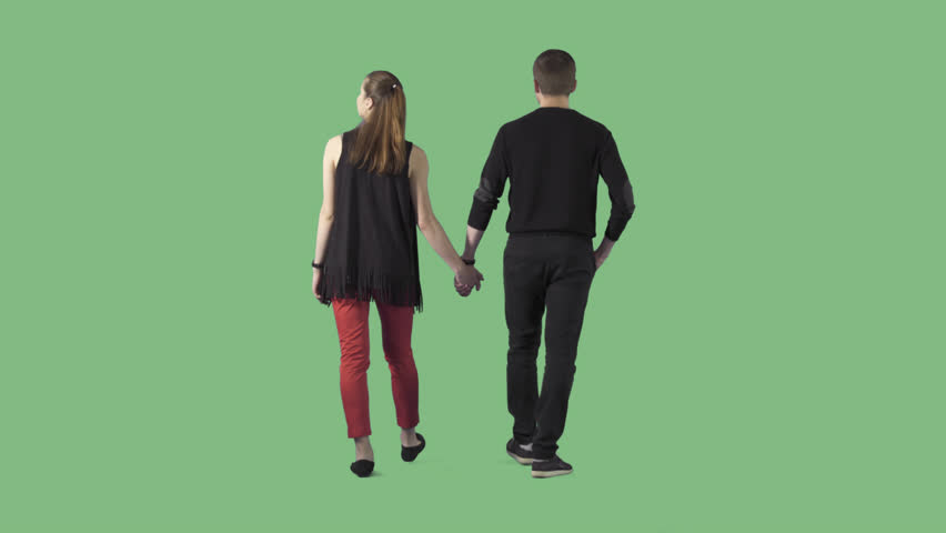 Young couple in casual clothes are slowly strolling away from the camera. The camera is static. Lens 85 mm. Footage with alpha channel. File format - .mov, codec PNG+Alpha