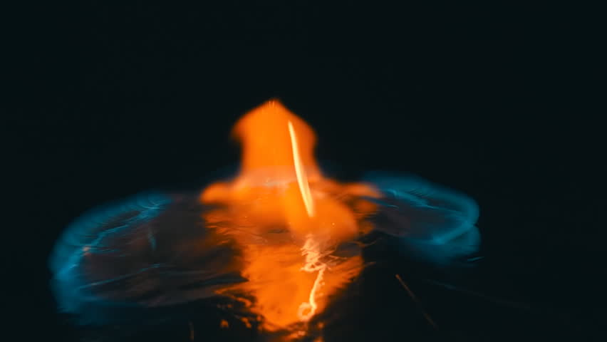 A lit match is fall down and ignites the gasoline. Blue wave at the forefront of fire go to meet. S-log - High Dynamic Range. Slow motion, high speed camera, 250fps | Shutterstock HD Video #17972314