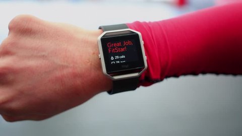 Hand with sports watch which shows results of training