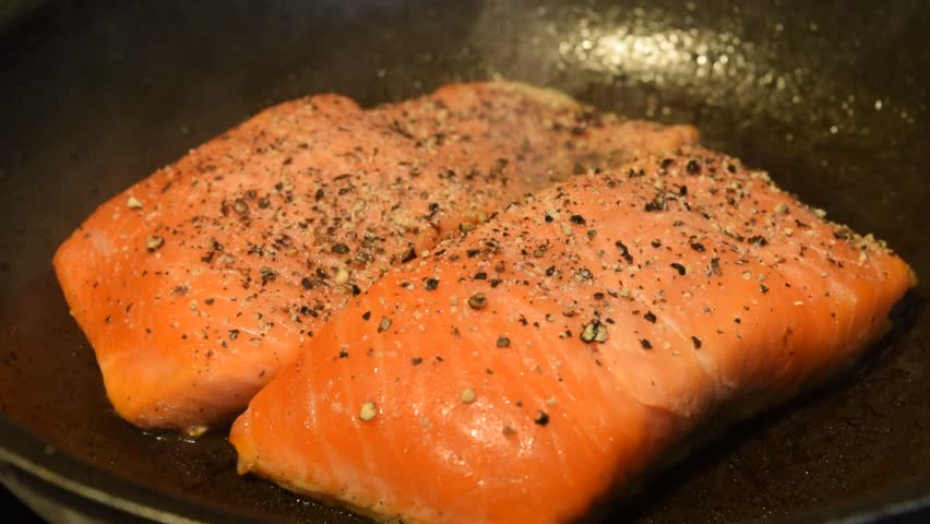Cooking salmon in an iron cast pan