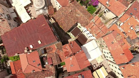 Flying over square and Serbian Orthodox church of St. Nicholas. Medieval old tow in Kotor city, Montenegro. Top view