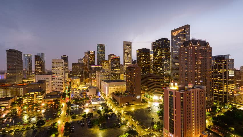 Houston, Texas, USA day to night skyline with stormy skies.