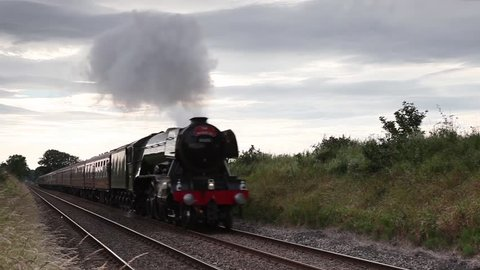 SCOTBY, ENGLAND - JULY 17:  Preserved steam locomotive the Flying Scotsman at the head of The Waverley in Scotby, Cumbria on July 17, 2016.