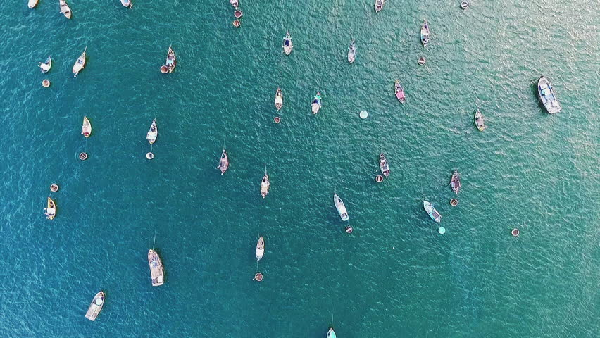 Aerial video over the sea and above a lot of fisherman boats in Asia, Vietnam, Mui Nè.