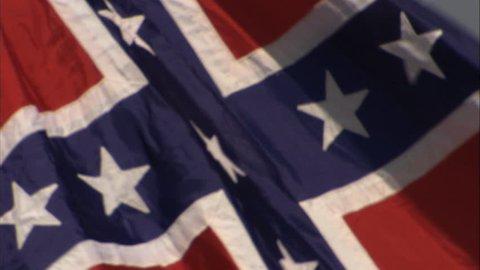 VIRGINIA - OCTOBER 2014 - 150th anniversary Civil War anniversary reenactment.  Living History. Confederate / Rebel / CSA battle flag in wind.  Confederate Soldier flag from Civil War battle.
