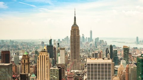 New York City, United States - July 7, 2016: Time lapse view of New York City skyline including the Empire State Building and Freedom Tower in Manhattan, New York, United States - zoom out.