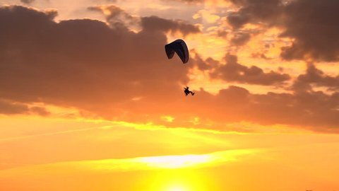 Paramotor Flying at Sunset and Beautiful Clouds