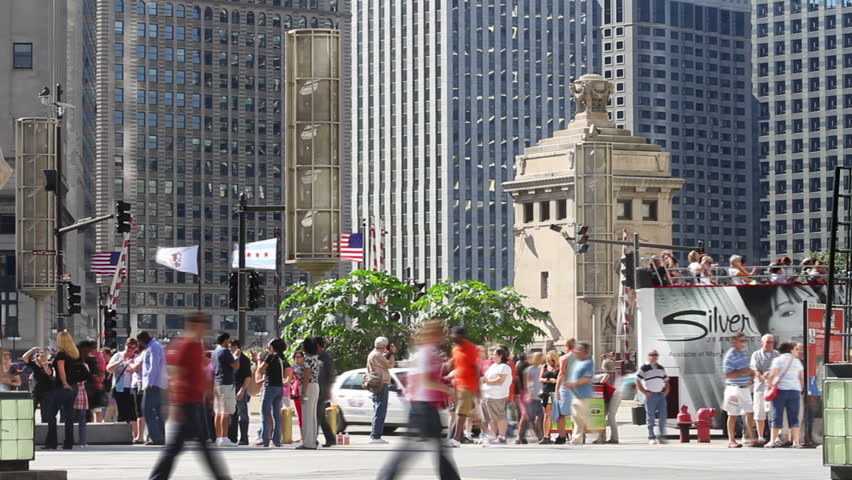 CHICAGO - CIRCA SEPTEMBER 2011 - Time lapse, tourists walk along Michigan Avenue near Wacker Dr., with skyscrapers in the background | Shutterstock HD Video #1817942