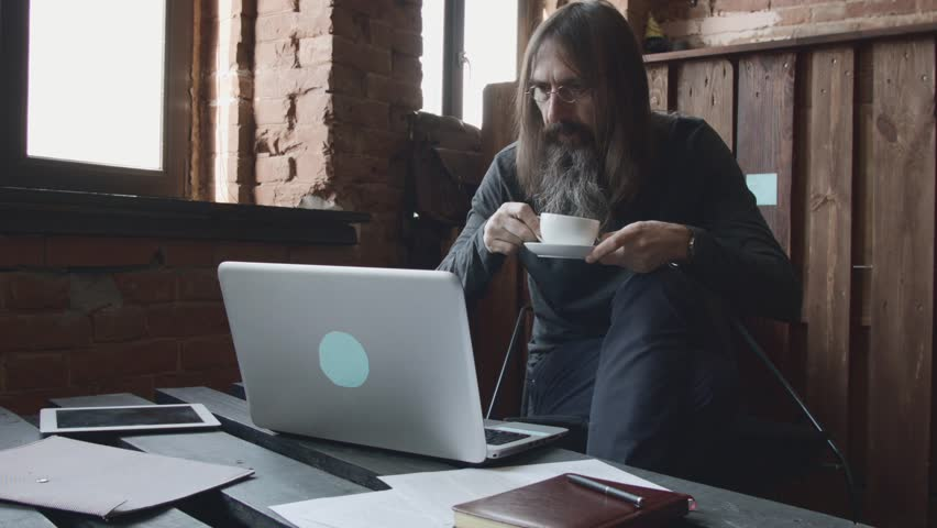 Creative bearded businessman working on laptop in cafe   Shutterstock HD Video #18191524