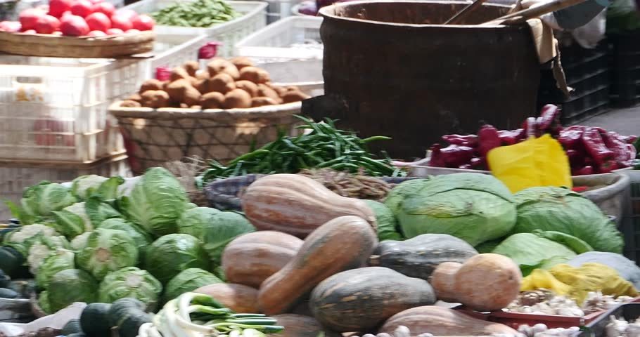 Oct 20,2015:4k large outdoor vegetable trade market in Shangri-La,china,minority women,variety of vegetables & fruits in basket. gh2_10693_4k