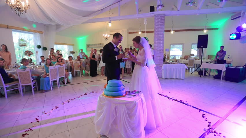 Beautiful Delicate Bride And Handsome Groom Give Each Other Piece Of Cake At Wedding Party In